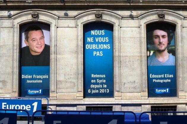 Les portraits de Didier François et d'Edouard Elias sur la façade d'Europe1